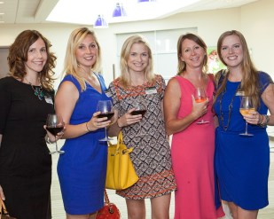This example photo of five women demonstrates our goal to photograph as many people at an event to increase social media appeal.