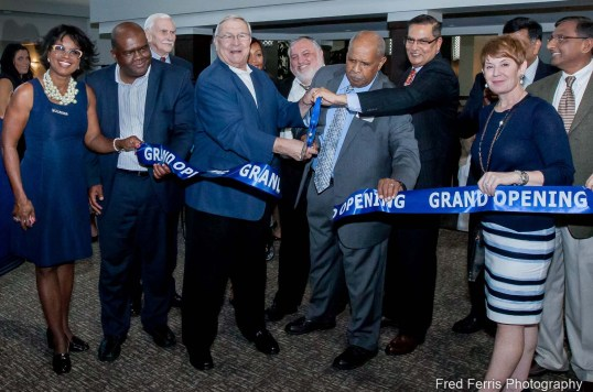 This is an event photograph that shows we capture action and expression as L. Brooks Paterson officiates Grand Opening of Best Western Premiere Detroit.