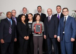 This is an award ceremony group photo of 10 people. We do the posing, lighting, retouching. You take the Credit.