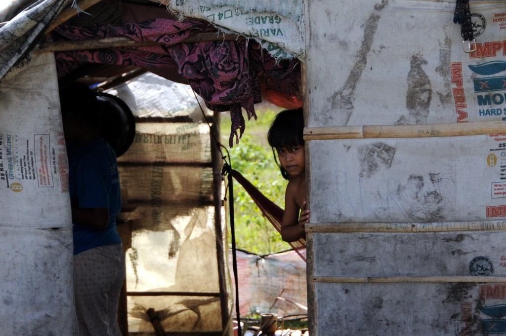 Displaced girl peeking
