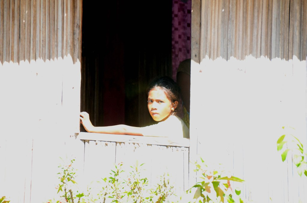 Girl watching out of her window