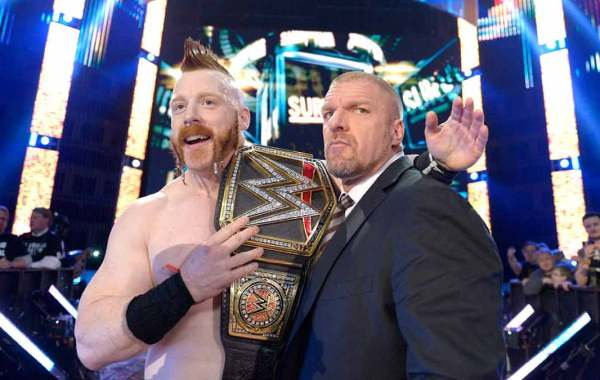 "WWE wrestler Sheamus and executive Paul ""Triple H"" Levesque. Courtesy of WWE.com."