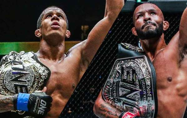 ONE Championship flyweight champion Adriano Moraes and former UFC flyweight champion Demetrious Johnson. Courtesy of ONE Championship.