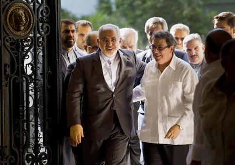 Iranian Foreign Minister Mohammad Javad Zarif, is welcomed by Cuban Foreign Minister Bruno Rodriguez, in Havana, Cuba
