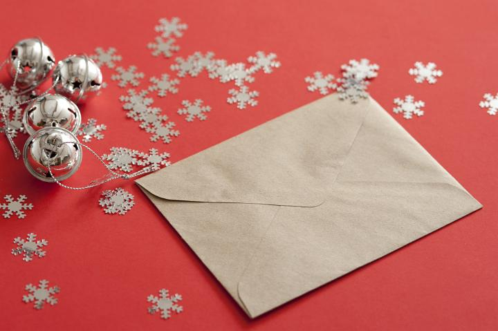 Christmas Card on Table with Snow Flakes and Bells by freebie.photography