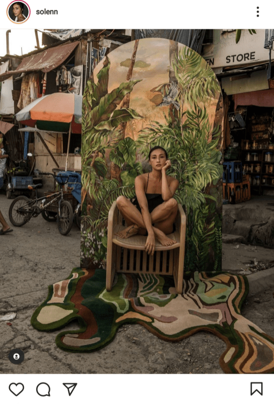 Solenn Heussaff received backlash after sharing this photo of her painting with the urban poor community as background.