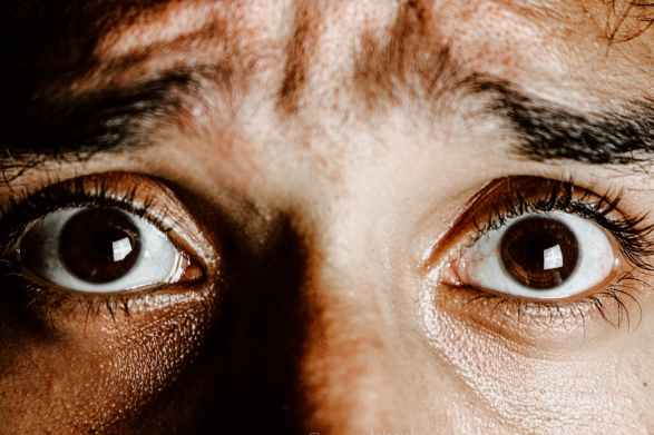 brown eyes of scared young person | Do You Have This Hole Phobia?