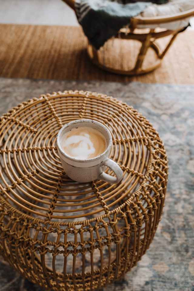 coffee placed on wicker table in house