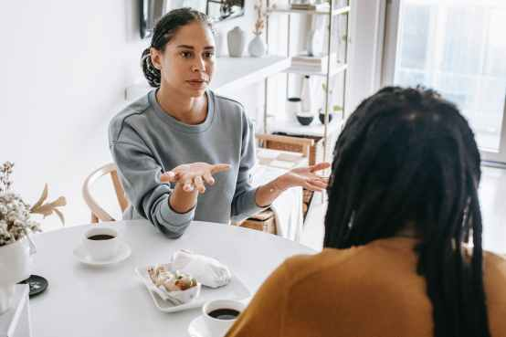 black couple having conflict at table