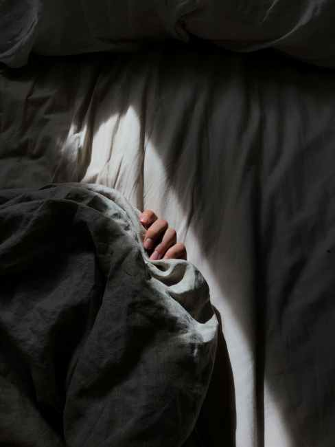 person covered with gray blanket