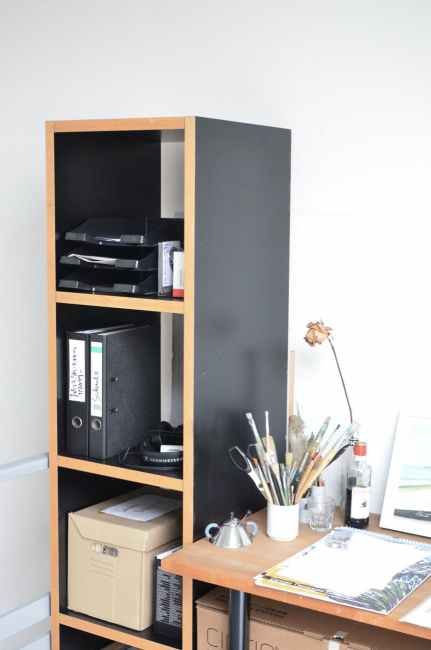 working desk placed near shelf with various folders