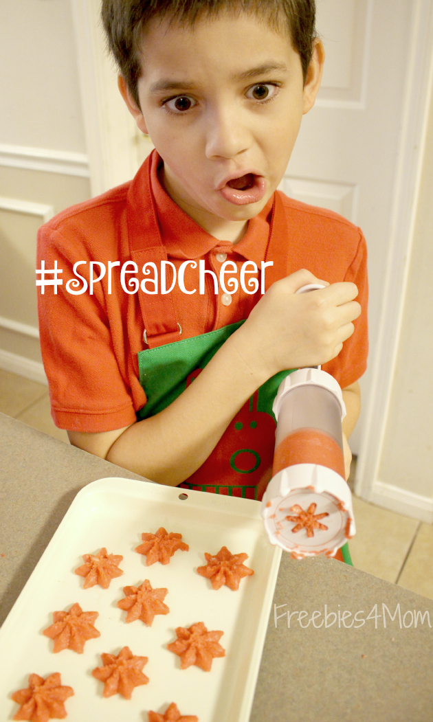 Using cookie press for Poinsetta Cookies to #SpreadCheer