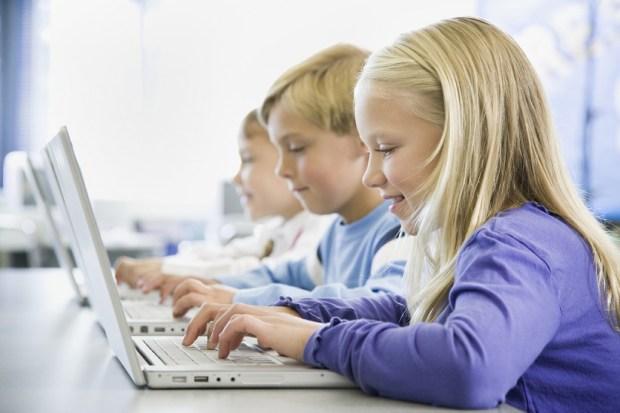Schoolkids Working on Laptops