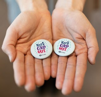 Get 2 Free Keep Girls Safe Buttons from Adra