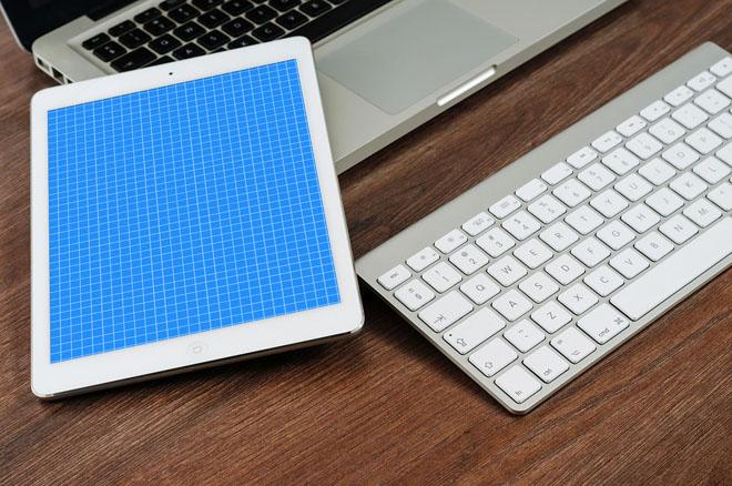 Free iPad Mockup Over Wooden Table