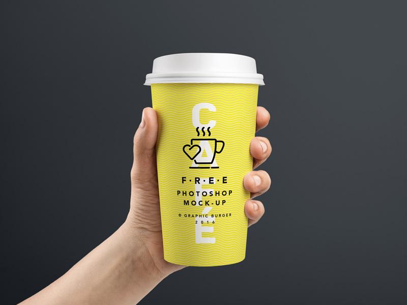 Realistic Hand Held Coffee Cup Mockup