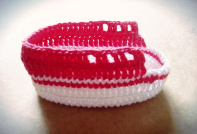 Crochet shoe for baby being produced