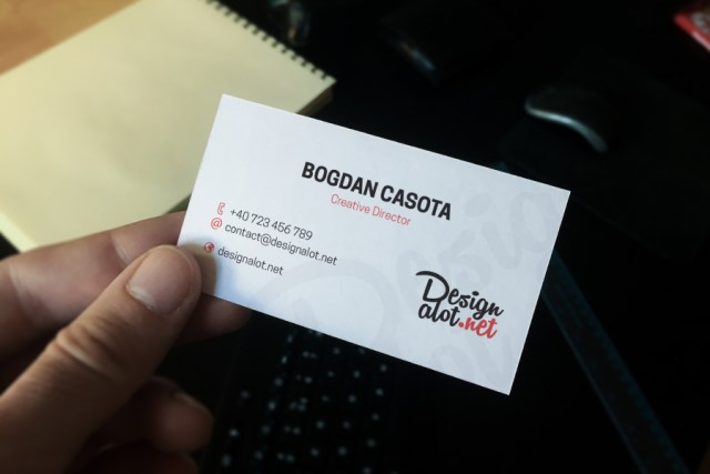 Business Card in Hand Mockup Sample