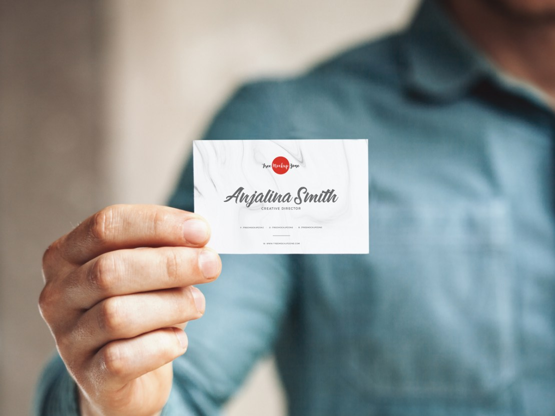 Man holding business card mockup free design resources man holding business card mockup reheart