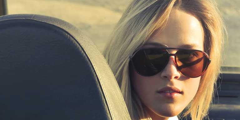 Girl in car - photo by: Bruce Mars