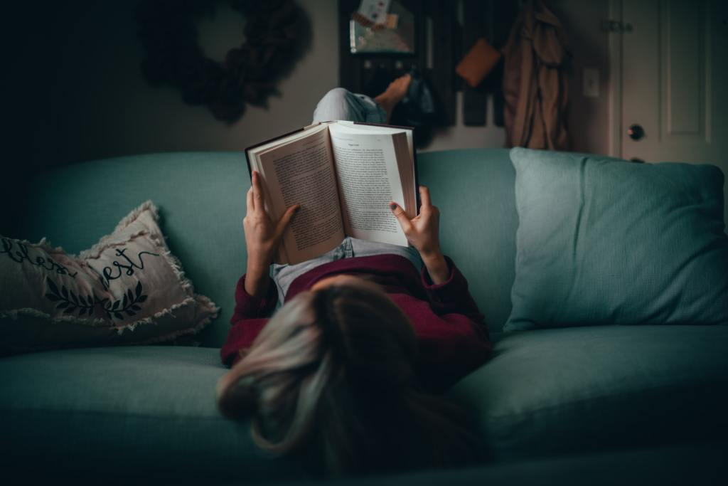 Analog activities - girl reading on a couch