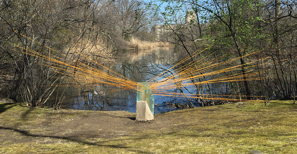 """Node Hissed, 2018. Freedom Baird. Living plants, sheet acrylic, steel brackets, concrete block, spackle, latex paint, dust, nylon cord, shock cord. Studios Without Walls """"Beyond Boundaries"""" exhibition. Riverway Park, Brookline, MA"""