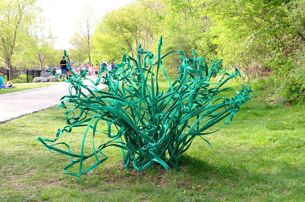Grass Extension, 2015. Freedom Baird. Broadcloth, fusible interfacing, copper wire, aluminum mesh, nylon cord, cinderblock. 36 x 48 x 48 inches. Interactive sculpture, installed for the Art Rocks Spy Pond Elements Exhibition, Spy Pond, Arlington, MA