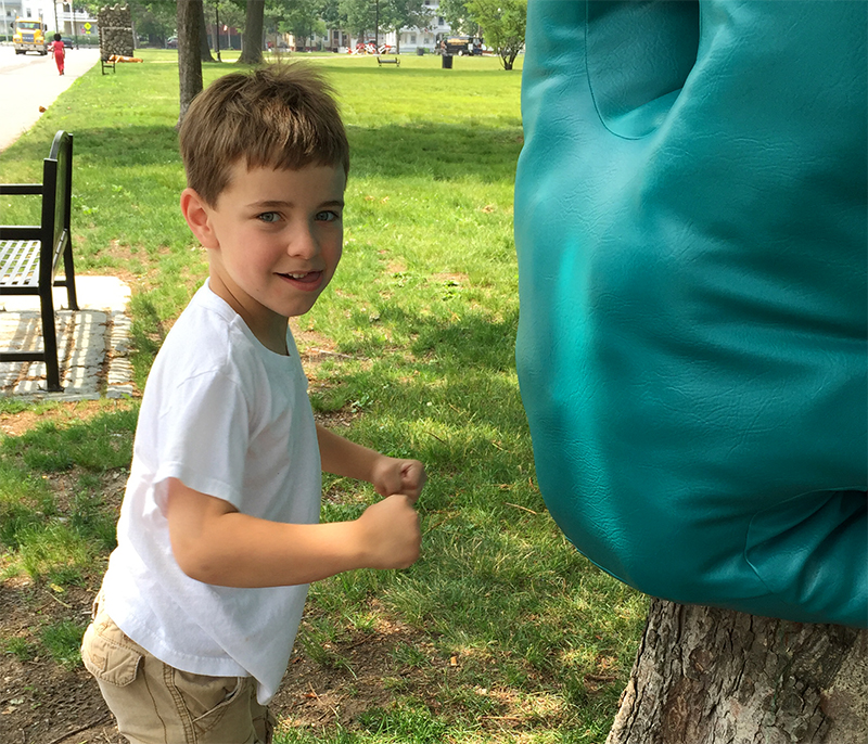 Touch Punch Trunk in use by a visitor, summer 2015, Elm Park, MA.