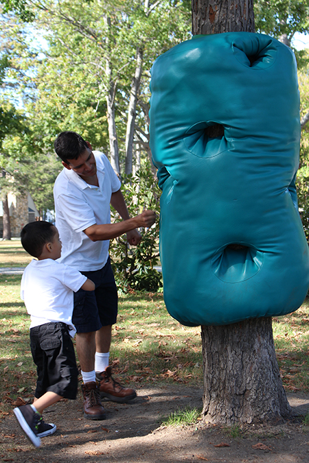 Touch Punch Trunk in use by visitors, summer 2015, Elm Park, MA. Freedom Baird