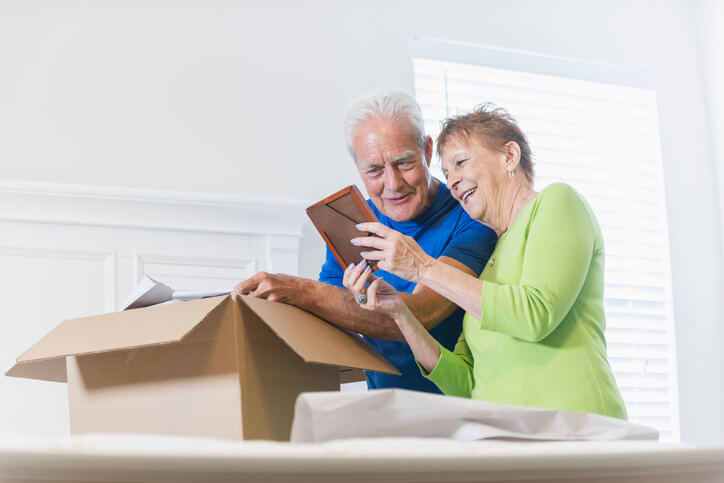 A senior couple packing up their things and facing the challenges of downsizing.