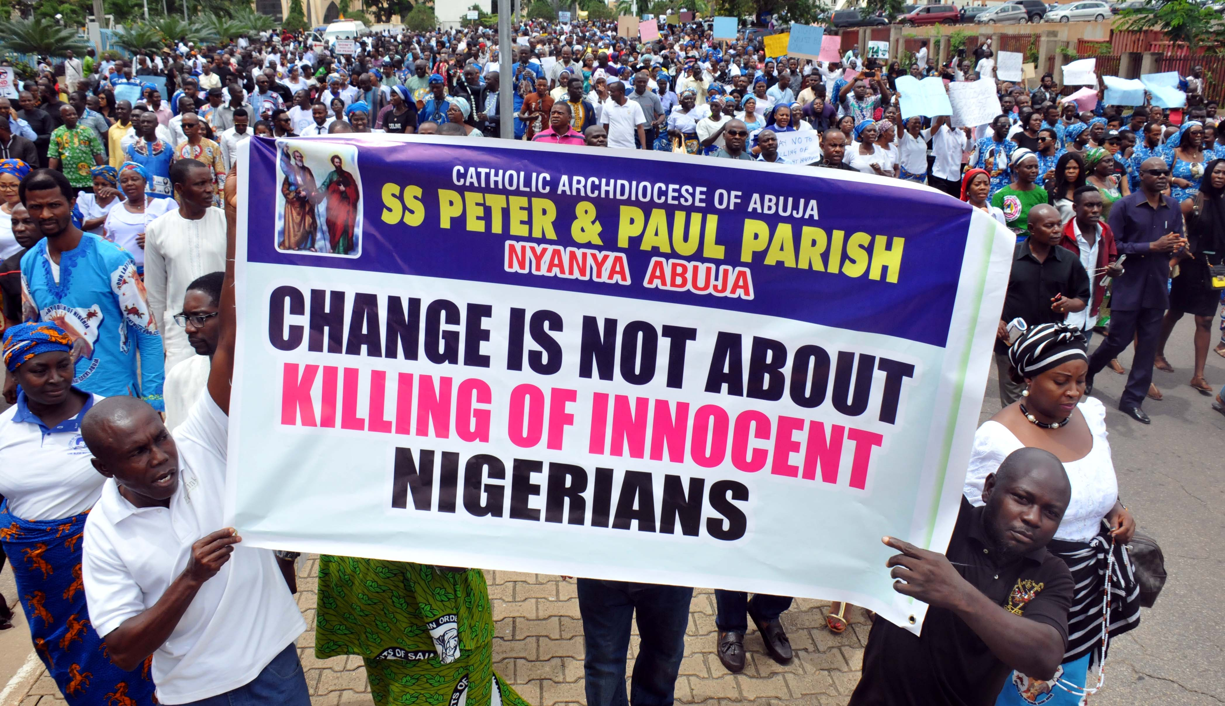 Image result for Christian children pray during a protest in Makurdi, Nigeria, photos