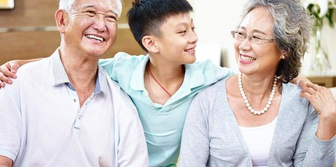happy grandparents with grandson