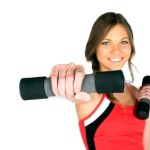 A woman smiling and exercising with dumbbells.