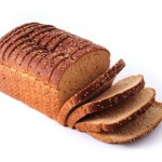A sliced loaf of whole grain bread.
