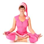 A woman doing yoga in a Christmas outfit.