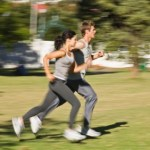 A couple jogging in the park.