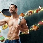 A man with toned abs and a frying pan surrounded by food.