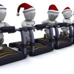 Silver figures in Christmas hats running on treadmills.