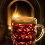 A mug of beer in front of an open fire.