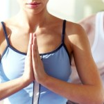 A close up shot of a woman at a yoga class.