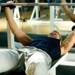 A man performing the bench press.