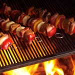 Kebabs being grilled on a barbecue.