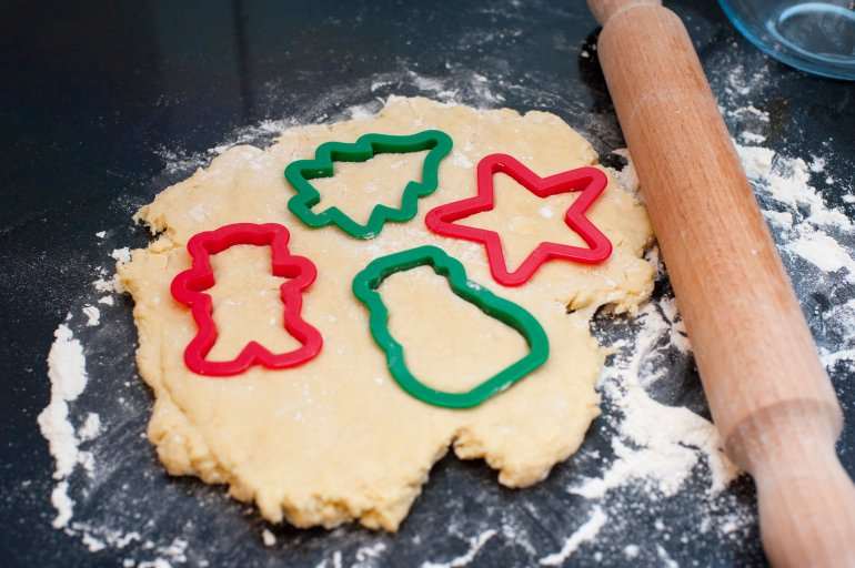 Rolled Pastry Dough With Cookie Cutters Free Stock Image