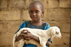 Heifer International girl with baby goat
