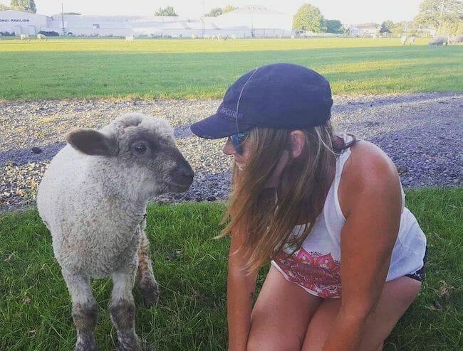 woman smiling at lamb