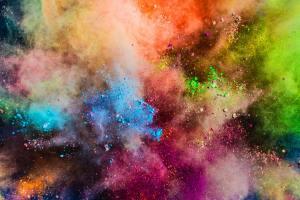 Colorful powder splashing in the air.
