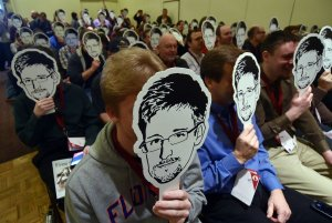Crowd Holding Snowden Masks
