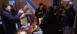 Jummah attendees gather in the kitchen afterwards for some homemade treats.