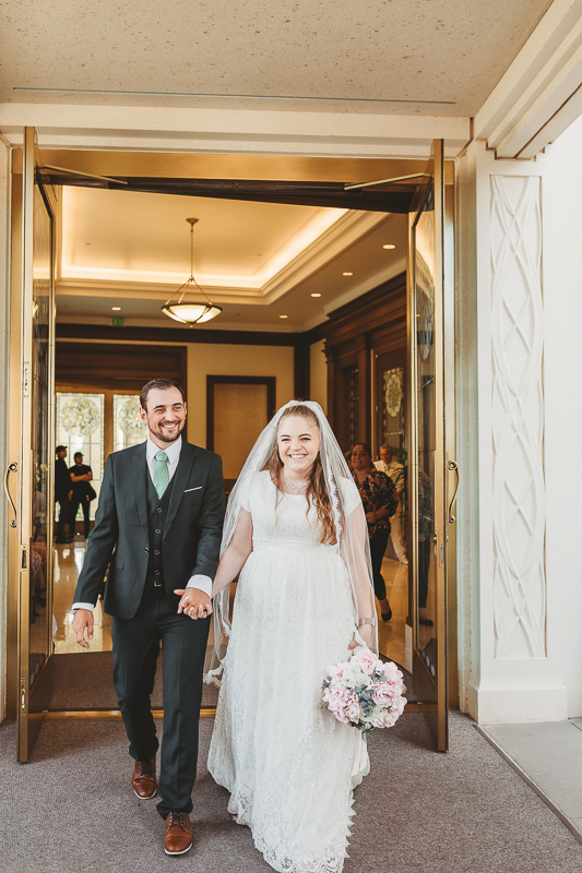 LDS wedding bride and groom photos exiting Gilbert Temple