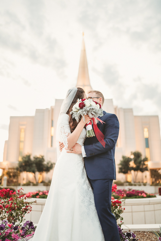 LDS wedding bride and groom photos kissing at the Gilbert AZ temple